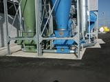 Materialaustrag über Zellenradschleuse und anschließender pneumatischer Förderung