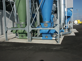 Material discharge via rotary valve and pneumatic conveyance