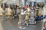 ENDLESS SCREW DOSING SYSTEMS FOR POWDERS AND FIBERS