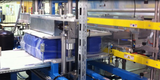 Packaging machine for canisters