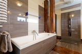 modern brown bathroom with bathtub PFEG5ZX
