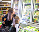 Copy of stock photo 31356212 mother and daughter in supermarket near frozen food